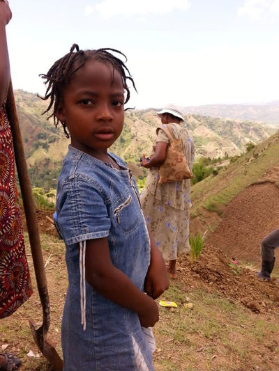 Ti fi (little girl) - Future Haitian leader learning the skill sets of terrace farming and reforestation methods from her parents and community leaders in a new area of development called CODEP 2.
